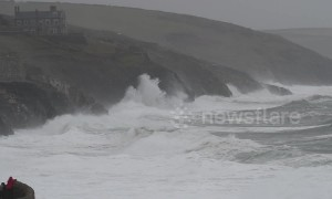 Waves smash UK coast as Storm Gareth tightens its grip