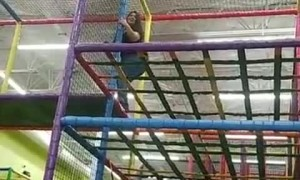 Grown Ups Playing in the Jungle Gym