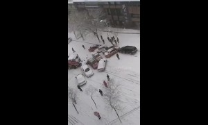 Over a dozen vehicles skid into pile-up in snowy conditions