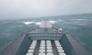 Navy ship battles huge waves at sea