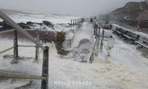 Sea foam froths into wind as Storm Gareth strikes Dorset