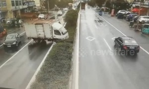 Out-of-control lorry swerves and smashes through embankment on Chinese town road