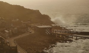 UK coastline thrashed by Storm Gareth during sunset