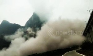 Massive landslide casts huge dustcloud in China's Guangxi