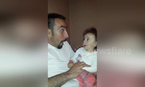 Dad and baby daughter trade funny faces in this utterly adorable clip