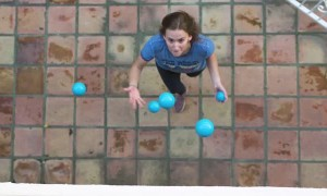 Woman Juggles 5 Balls at Once