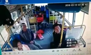 Motorist brakes in front of bus so his wife can get on