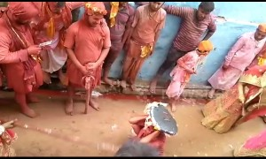 Women beat men with sticks during traditional north Indian festival