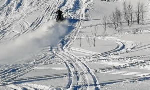 Snowmobile Tries to Climb Super Steep Hill