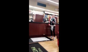 Woman drops bottle of wine in US shop