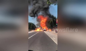 Driver has to reverse to escape burning truck full of exploding butane tanks