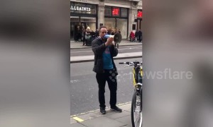 Passionate protester rants into megaphone outside Apple store in London