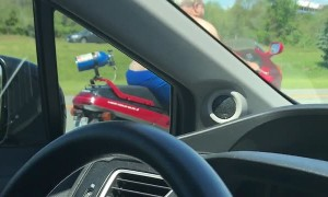 Shirtless Man Moseys Down Highway on Motorcycle
