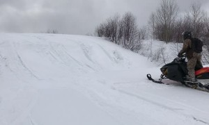 Snowmobile Rider Takes a Spill