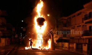 Spanish town burns massive head sculpture in fiery festival finale