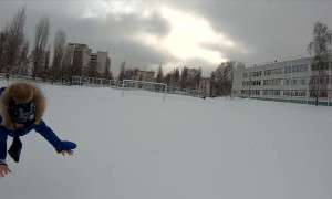 Dad Launches Kid into the Snow