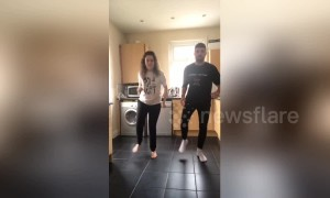 Siblings use kitchen tiles as synchronised dance mat