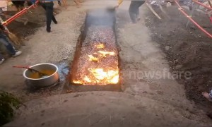 Woman falls into red hot coals during Indian festival
