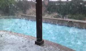 """Golf ball-sized hail"" makes North Texas pool look like frenzy of piranhas"