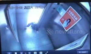 Old Chinese woman narrowly escapes death climbing out of malfunctioning elevator