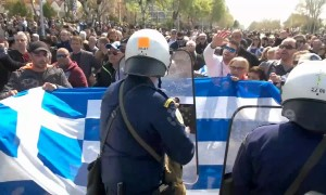 Tension flares as Greek protesters clash with police over Macedonia name deal
