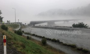 New Zealand bridge washes away as 'monster' rainstorm batters South Island