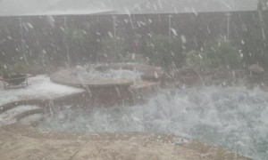 Hail Storm Batters Backyard Pool