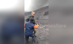 German tourist wrestles park ranger to ground after trying to hike erupting Indonesia volcano
