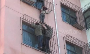 Chinese firemen rescue boy hanging from fourth-floor window of residential building