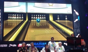 Crowd goes wild as elderly gamer scores a strike a bowling game competition
