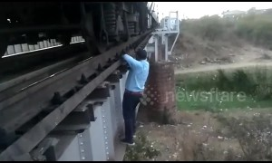 That's dedication! Brave train driver risks life to fix train after it stops on bridge in central India