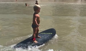 Cool Kid Surfs to Shore