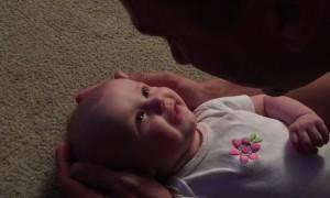 Baby girl has emotional reaction to dad's singing