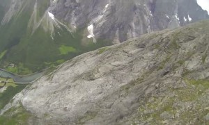 POV wingsuit flight over Norwegian mountainside