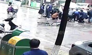 Good Samaritans in China lift car up together to save teen trapped underneath