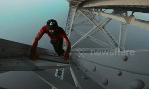 Fearless free-climber scales 'bridge over the clouds' in France