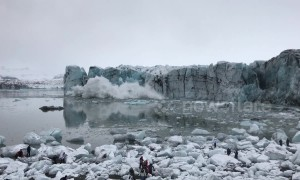 Moment massive glacier collapses in Iceland lagoon, sending tourists fleeing in panic