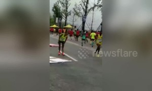 Bollards blown over by helicopter livestreaming Chongqing marathon race injure one runner