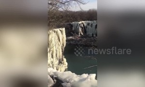 Veteran pro diver leaps from freezing 65ft-high waterfall