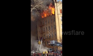Firefighters battling out-of-control 5-alarm fire in Brooklyn building