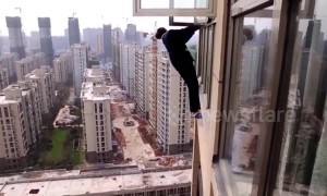 Robber tries to escape police climbing out of 22nd-floor window in China's Hunan