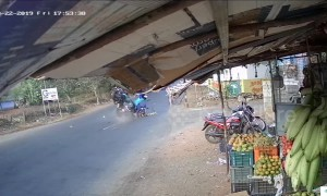 Horrific moment two mopeds smash together in the middle of a busy road