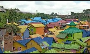 Former slum in eastern Indonesia rebuilt into 'rainbow village'