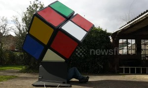 Ingenious UK man solves giant Rubik's Cube from the INSIDE