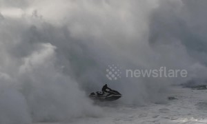 Surfer's massive wipeout followed by incredible jet ski rescue in Portugal
