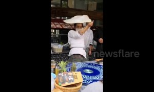 Kung fu master shows off Tai Chi moves while spinning roti pirata dough