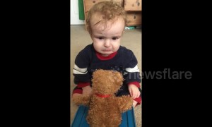 Baby gets scared of cuddly Jack-in-the-box surprise