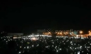 Thousands protest outside Sudan army HQ with phones in the air