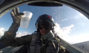 Pilot drinks water from cup while flying upside down