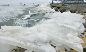 Spectacular video shows ice on Chinese lake spilling onto shore during melt